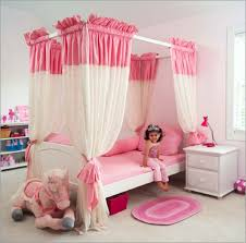 simple little girls bedroom design ideas with white wooden bed