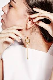 one earring five single statement earrings to try into the gloss
