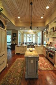 center kitchen islands southern coastal homes with a bigger center island though ceiling