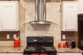natural stone backsplash kitchen mission style cabinet doors modern stainless steel convertible range hood with exposed natural stone backsplash electric stove marble countertop white traditional cabinet red holder