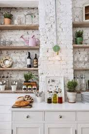 kitchens with brick walls eclectic white kitchen brick wall