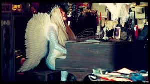 the wings in the clip praying to kesha spotern