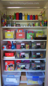 learn with play at home organisation ideas for an art craft cupboard