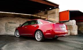 lincoln mks vs cadillac xts 2015 cadillac xts vsport review strangely predictably