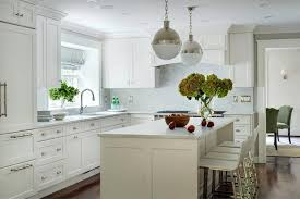 white l shaped kitchen with island white kitchen with polished nickel hicks pendants transitional