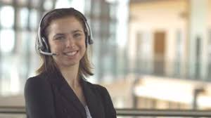 Customer Service Call Centre by Call Centre Young Woman With Headset Talks To A Customer