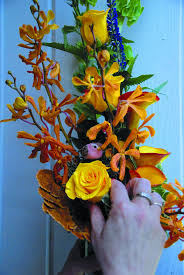 when it comes to creative holiday flower arrangements think