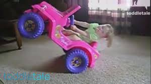 pink toy jeep toddler does wheelies in a power wheel active toddlers