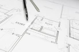 custom house plan engineer pencil and ruler resting on custom house plans royalty