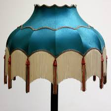turquoise lampshade with white tassels ten and a half thousand