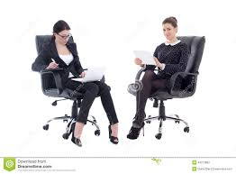 two beautiful business women sitting on office chairs with table