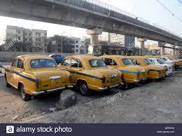 sell peugeot kolkata india 23rd feb 2017 yellow ambassador taxi parked