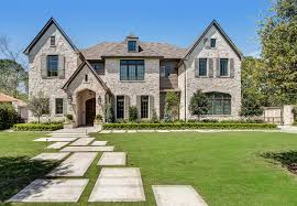 stone home with transitional french country interiors home bunch