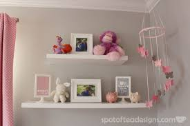 pink white and grey nursery for a baby room tour