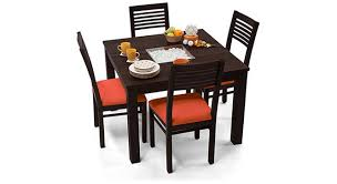 4 seater dining table with bench brighton square zella 4 seater dining table set urban ladder