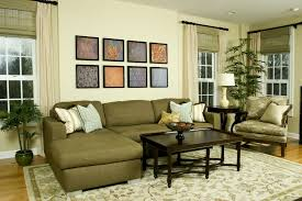 olive green sofa with chandelier carpet blue and