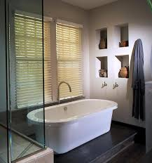 interior design for small bathroom with white standing tub and