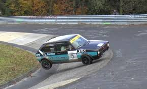 old golf gti and opel kadett crash at the nurburgring u0027s karussell