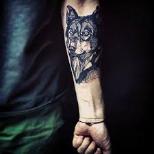 grey ink wolf on forearm