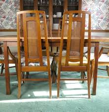 mid century modern dining table with six cane back chairs ebth