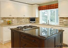 yellow backsplash with white cabinets beige cabinet ornamental