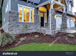 covered porch design front covered porch design boasts stone stock photo 564058477