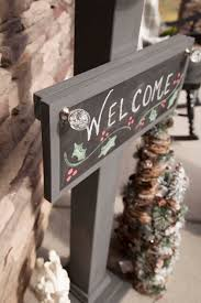 chalkboard welcome sign and sign post