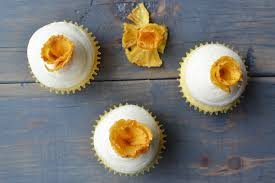 pineapple cupcakes with pineapple flowers and cream cheese