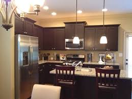 kitchen white spring granite with espresso cabinets and mini