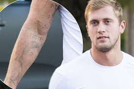 dan osborne shows off his faded tattoos as he attempts to u0027break