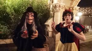 the witch as old hag offers snow white an apple at mickey u0027s not so