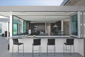 bi fold windows slide open to incorporate the outdoor bar seating