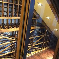 a small area under the stairs was brought to life by a wine cellar