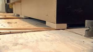 how to level kitchen base cabinets how to level and attach kitchen cabinets today s homeowner