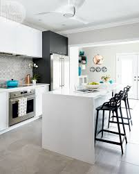 a stylish kitchen update for a toronto pr maven style at home designer amy dillon grounded the white cabinetry with dark grey accents but only a few i wanted the space to age gracefully not look like that typical