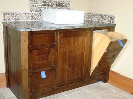 tall bathroom cabinet with laundry basket bathroom design