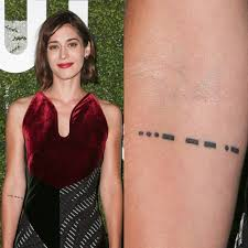 lizzy caplan u0027s tattoos u0026 meanings steal her style