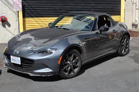 mazda car symbol 2017 fiat 124 vs 2016 mazda mx 5 what two miata faithfuls think