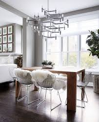 neutrals that wow minimal chicago townhouse with inviting warmth view in gallery minimal dining room table smart chandelier and plush textures shape a stunning dining room
