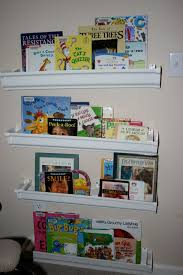 Vinyl Rain Gutter Bookshelves - very clever idea to keep your books organized and clean up fun for