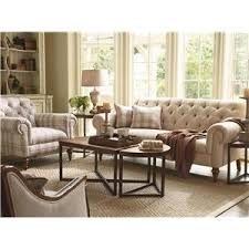 schnadig lynn button tufted sofa with exposed wood legs and rolled