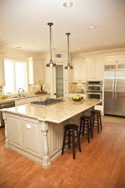 broken white wooden kitchen island with cream marble top combined
