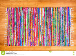 close up colorful hand woven rug on bamboo floor stock photo