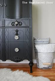 Painting Furniture Black by A Tall Black Dresser With Glass Knobs The Weathered Door