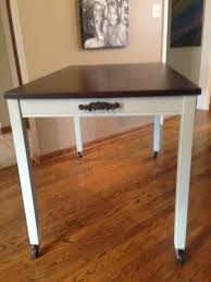 ikea table turned into a kitchen island rust oleum chalked paint