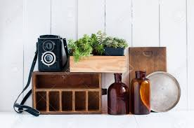 vintage home decor old wooden boxes houseplants camera and