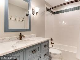 traditional full bathroom with penny tile floors u0026 undermount sink