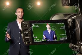 green screen photography television presenter in a green screen tv studio seen through