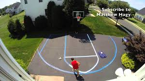 backyard basketball half court painted with different sports