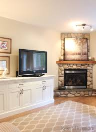 living room with corner stone fireplace tv stand that looks like